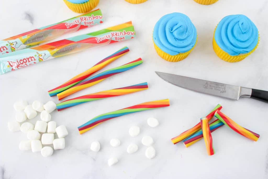Frosted Rainbow Cupcakes with Licorice ropes