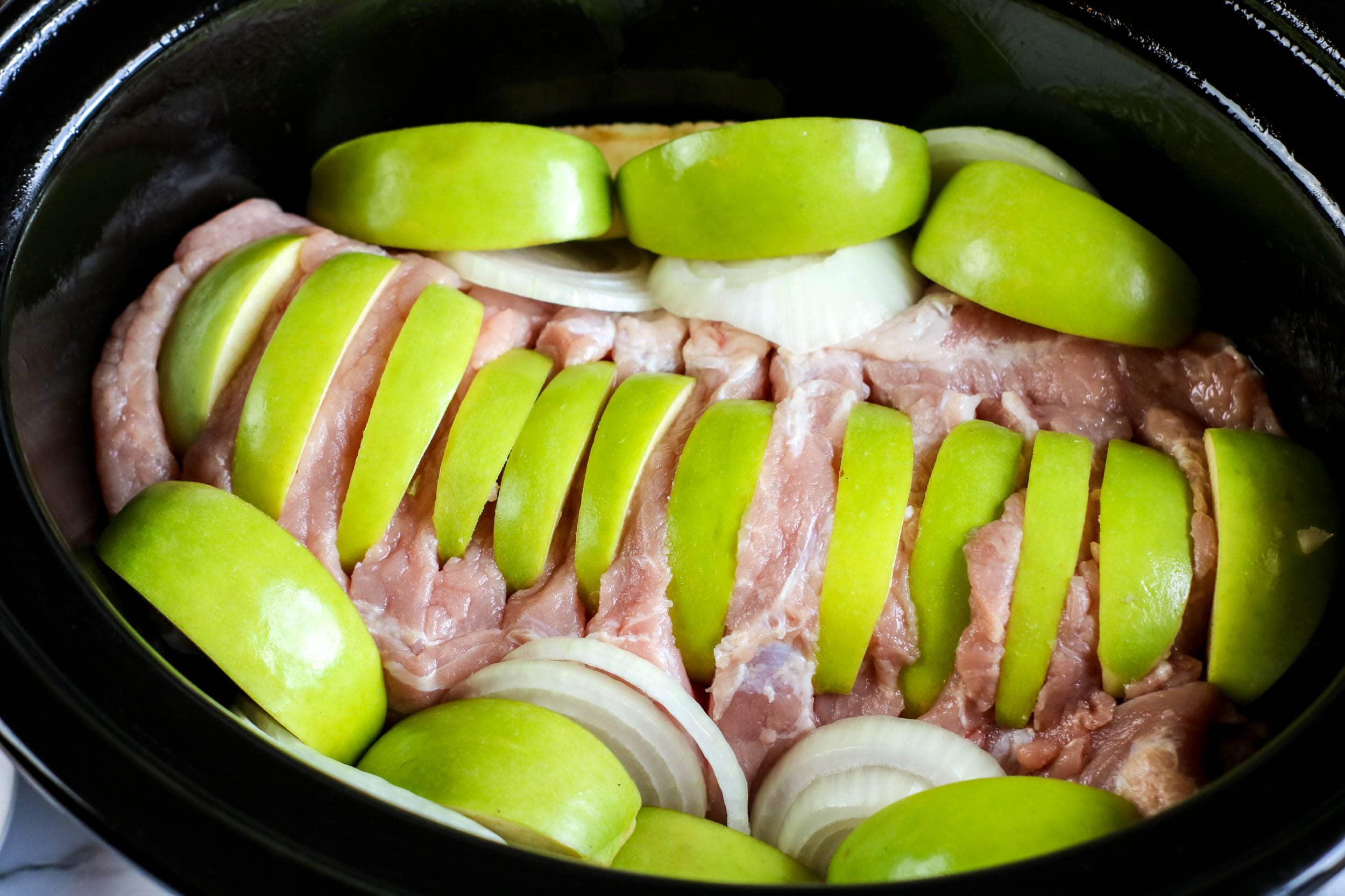 apples and meat in slow cooker