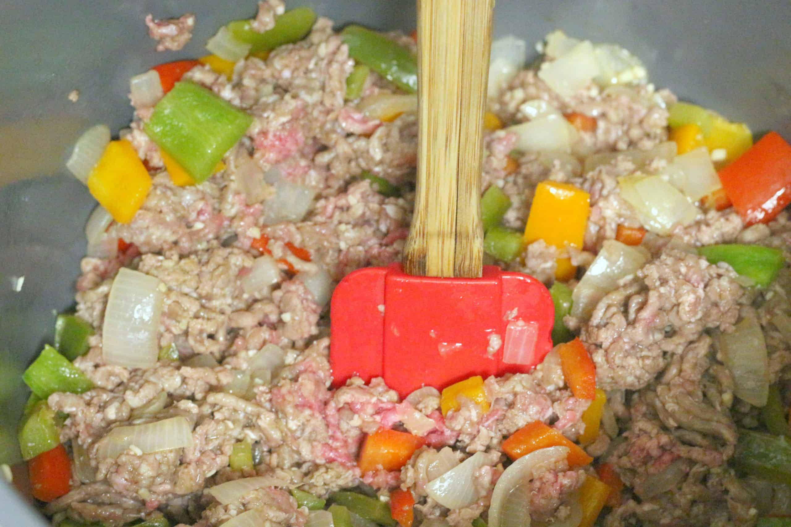 Ground beef, peppers and onions sauteing.