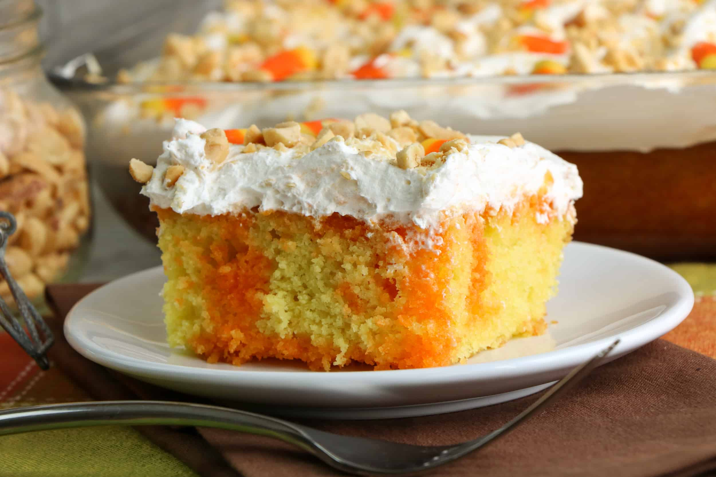 Candy Corn Poke Cake Slice