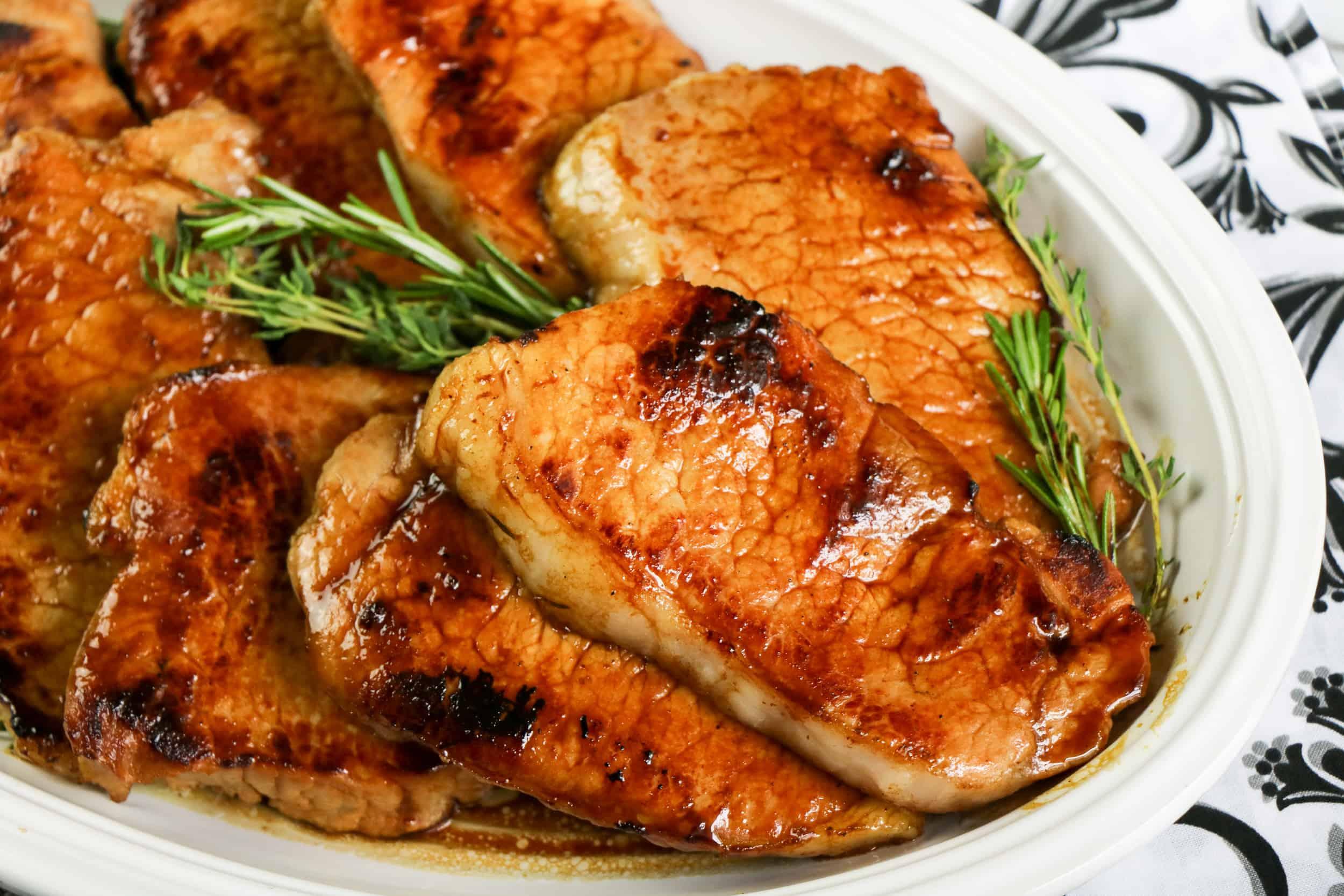 Plate of Pork Chops With Bourbon Molasses Glaze