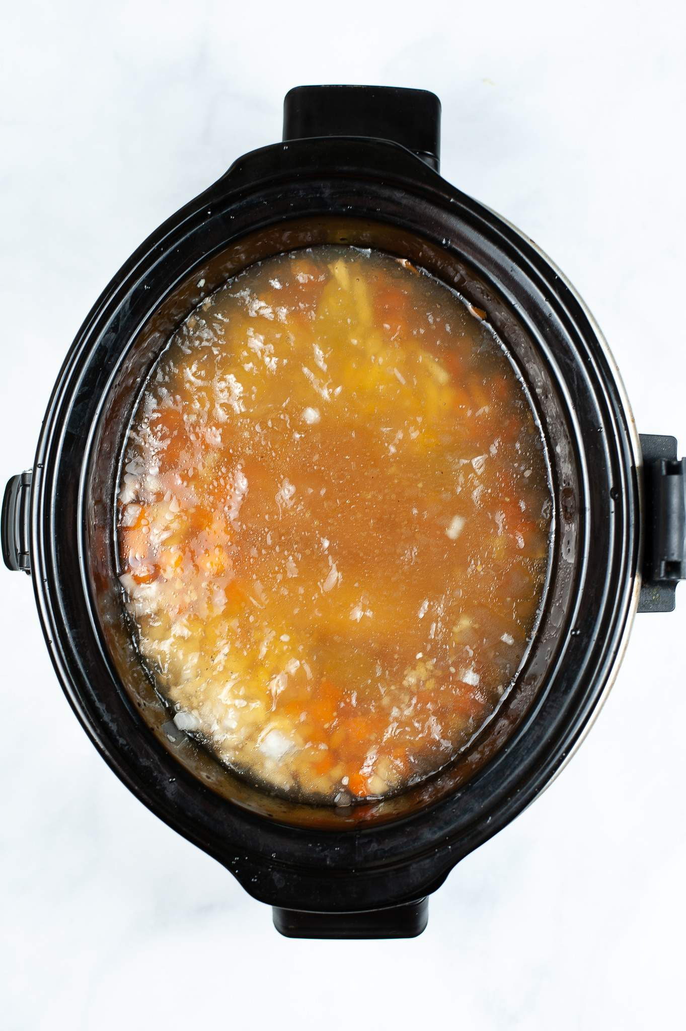 broth and veggies in slow cooker