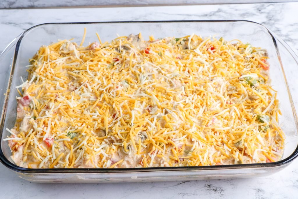 unbaked kings ranch chicken casserole with cheese on top