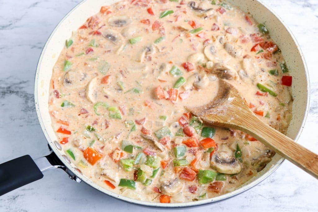 veggies in pan and cream sauce